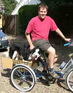 Kevin and dog Murphy on an adapted tricycle