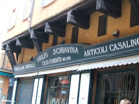 Bologna - Older portico in wood over traditional shop