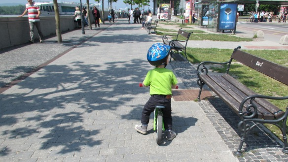 Child cycling by the Danube Bratislava