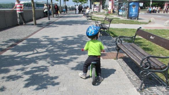Child cycling by the Danube Bratislava