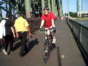 Cyclist on bridge over Rhine Cologne