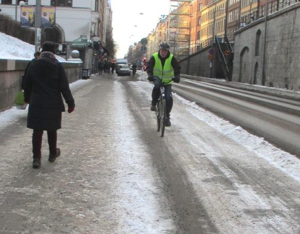 Cyclist Sodermalm snow Stockholm