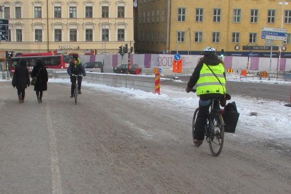 Cyclists on snow Slussen Stockholm