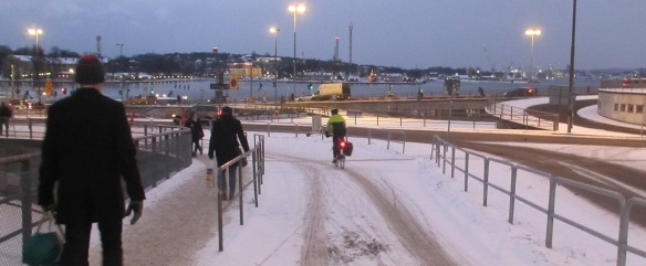 Descending Slussen cycle paths in snow Stockholm