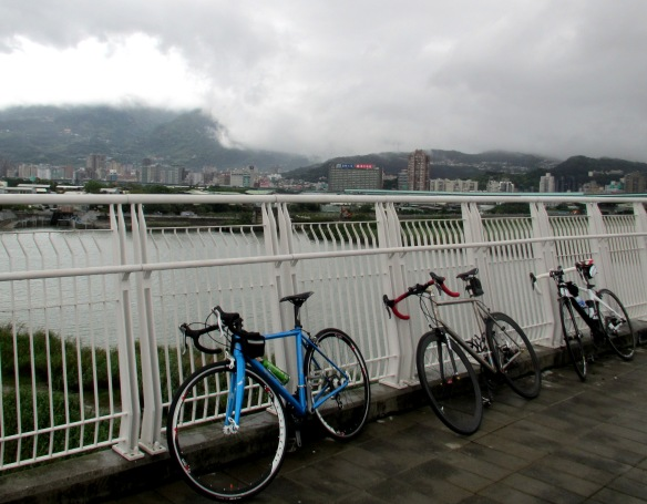 Bikes bridge and clouds Taipei