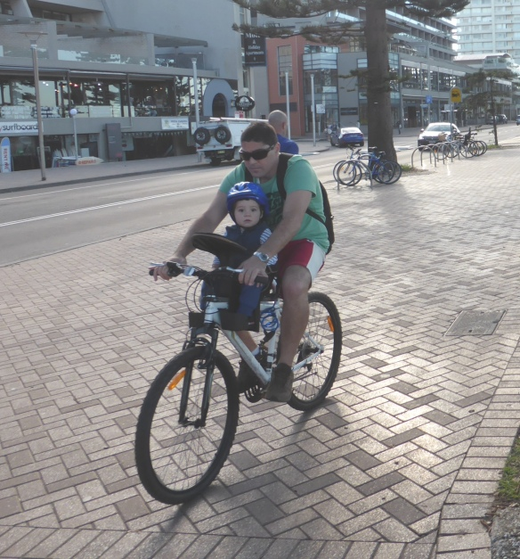 Cyclist with child at Manly