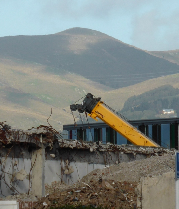 Earthquake Damaged buildings against the hills Christchurch