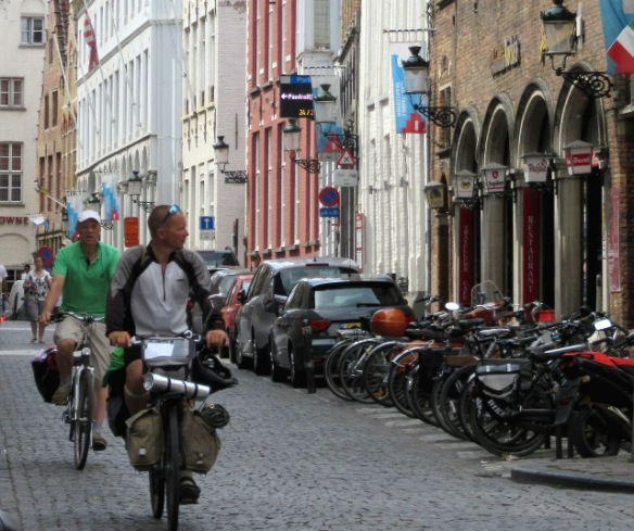 Cycling in Bruges by Kevin Mayne