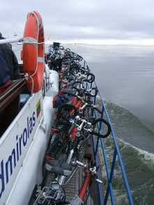 Bikes on the boat crossing Curonian lagoon Nida Lithuania